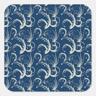 Tendrils del helecho en crema en azules marinos pegatina cuadrada
