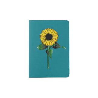 Tenedor del pasaporte del girasol con el fondo del porta pasaporte