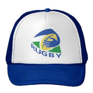 tenencia de la mano de la bola de rugbi gorra