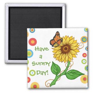 Tenga un imán del girasol del ~ del día soleado