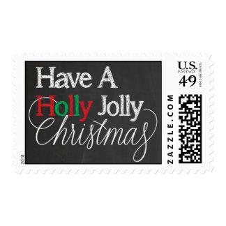 Tenga una pizarra alegre del navidad del acebo sellos postales