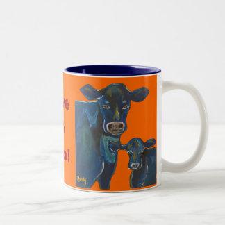 Tenga una taza de la vaca