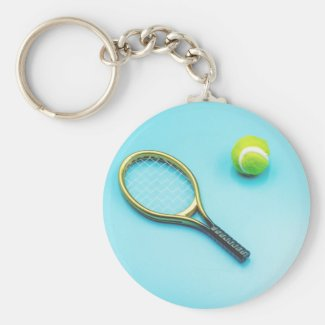 Tennis ball and racket are on blue background keychain