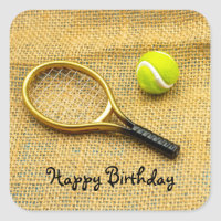 Tennis ball and racket on brown Birthday Sticker