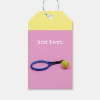 Tennis ball and racket on pink background gift tags