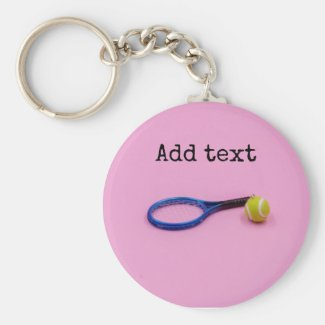 Tennis ball and racket on pink background keychain