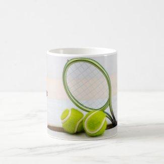 Tennis ball and racket on white background coffee mug