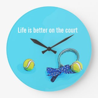 Tennis ball and racket with blue ribbon on blue large clock