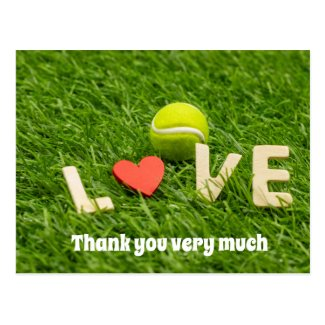 Tennis ball is on green grass with love thank you postcard