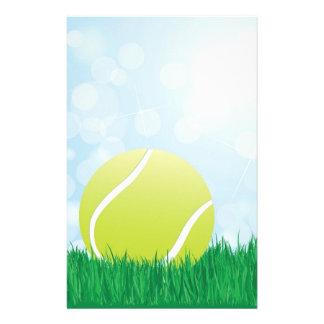 tennis ball on grass stationery design