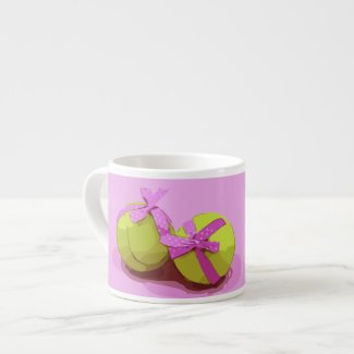 Tennis ball on pink background espresso cup