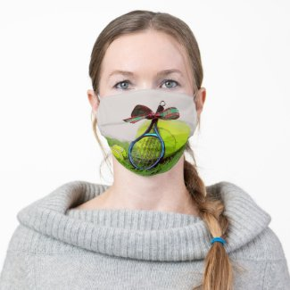 Tennis ball with Christmas ribbon are on green Adult Cloth Face Mask