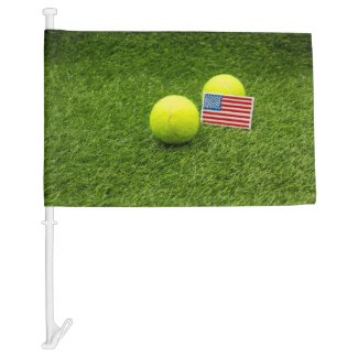 Tennis  ball with flag of America on green grass