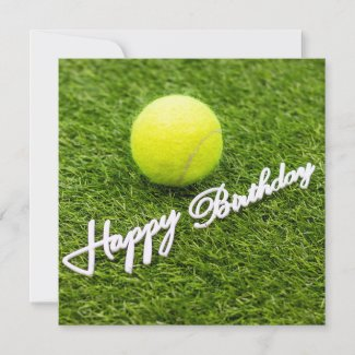 Tennis ball with happy birthday word on green card