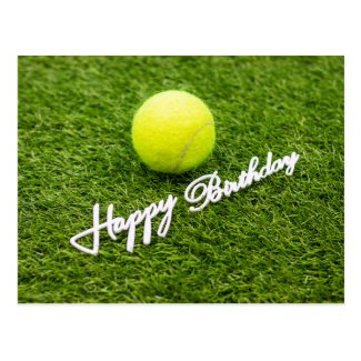 Tennis ball with happy birthday word on green postcard