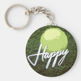 Tennis ball with happy word on green grass keychain