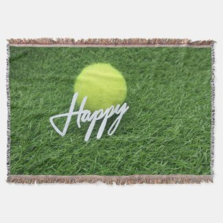 Tennis ball with happy word on green grass throw blanket