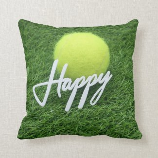Tennis ball with happy word on green grass throw pillow