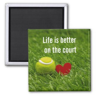 Tennis ball with love on green grass magnet