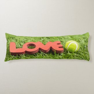 Tennis ball with love word on green grass body pillow
