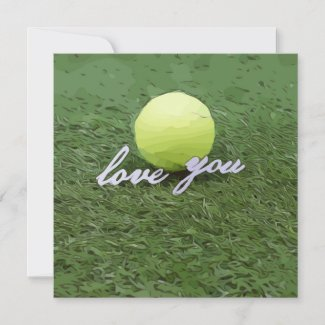Tennis ball with love you on green grass