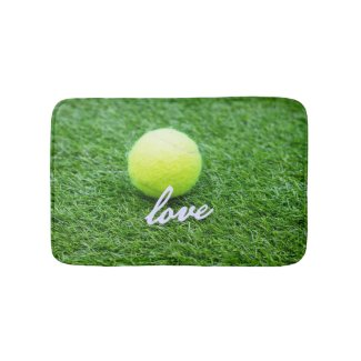 Tennis ball with love you on green grass bath mat