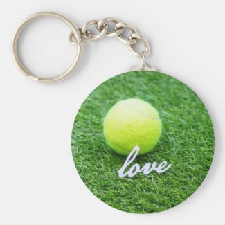 Tennis ball with love you on green grass keychain