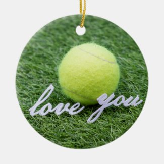 Tennis ball with love you sign on green grass ceramic ornament