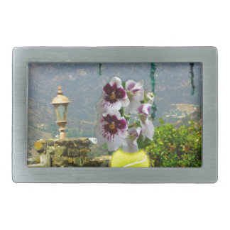 Tennis ball with orchids in a landscape rectangular belt buckle