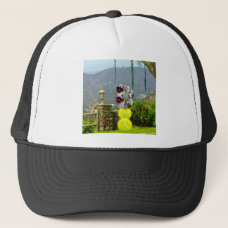 Tennis ball with orchids in a landscape trucker hat