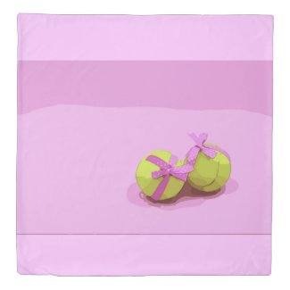 Tennis ball  with pink ribbon on pink background duvet cover