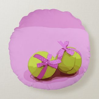 Tennis ball  with pink ribbon on pink background   round pillow