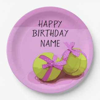 Tennis ball  with pink ribbon on pink birthday   paper plate