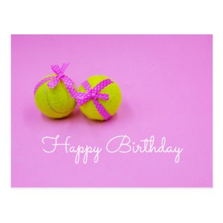 Tennis ball with pink ribbon on pink postcard