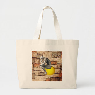 Tennis ball with thinker statue large tote bag
