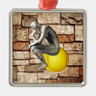 Tennis ball with thinker statue metal ornament