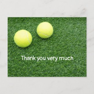 Tennis balls are on green grass thank you card