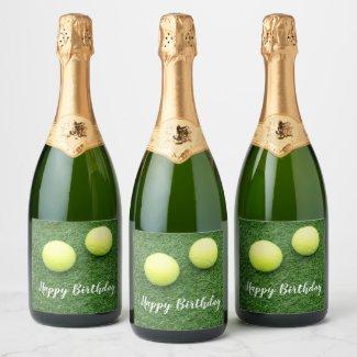 Tennis balls on green grass champagne label