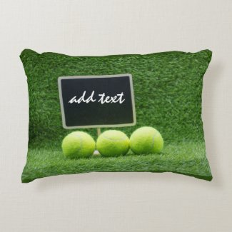 Tennis balls with chalk board are on green grass accent pillow