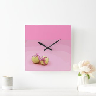 Tennis balls with pink ribbon on pink background square wall clock