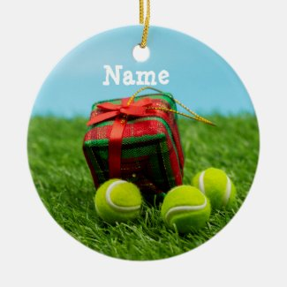 Tennis Christmas with gift ornaments on green