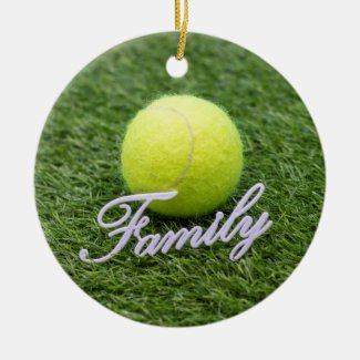 Tennis family with tennis ball on green grass ceramic ornament