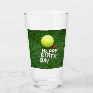 Tennis happy birthday with love on green grass glass