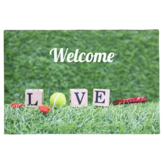 Tennis is on green grass with love welcome doormat