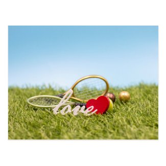 Tennis love with racket and tennis ball on green postcard
