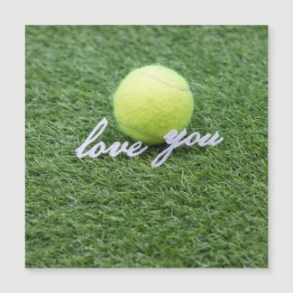Tennis love you with tennis ball on green grass