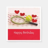 Tennis racket and ball on white and red background napkins