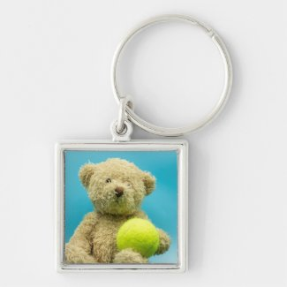 Tennis Teddy bear is holding tennis ball keychain