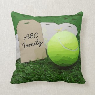 Tennis with family name with tennis ball on green throw pillow