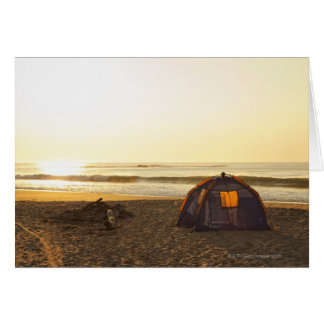 Tent and Burned out Campfire on the Beach. Card
